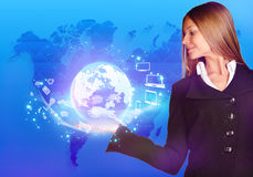 Business woman holding a globe on his hand with Stock Images