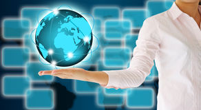 Business woman holding a glowing earth globe Royalty Free Stock Images