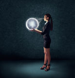 Business woman holding glowing planet earth Royalty Free Stock Images