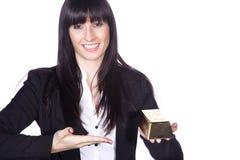 Business woman holding gold ingot. Sympathetic Business woman holding gold ingot Stock Photo