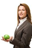 Business woman holding green apple. Business woman holding green apple Stock Photography