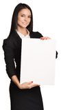 Business woman holding in hand a blank sheet of Royalty Free Stock Image