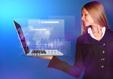 Business woman holding hand on a laptop with Stock Photo