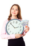 Business woman is holding in hands clock and money.Dollars  time Stock Image