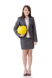 Business woman holding hat Stock Photos