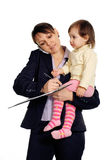 Business woman holding her daughter in her arms Royalty Free Stock Photos
