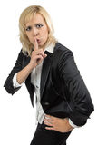Business woman holding her finger near the mouth Stock Photo