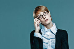 Business woman holding her glasses and looking up Royalty Free Stock Photo