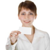 Business woman holding her visiting card Royalty Free Stock Photos
