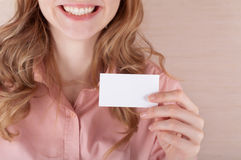 Business woman holding her visiting card Royalty Free Stock Photo