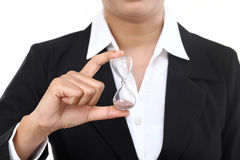 Business woman holding hourglass Stock Photo