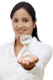 Business woman holding hourglass Royalty Free Stock Image