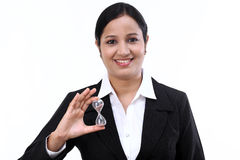 Business woman holding hourglass. Against white stock image