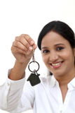 Business woman holding house key Stock Photo