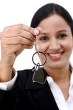 Business woman holding house key Stock Images