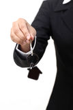 Business woman holding house key Royalty Free Stock Image
