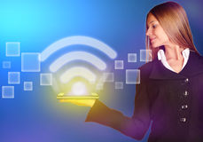 Business woman holding an icon wi-fi with a bright Stock Image