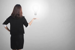 Business woman holding idea bulb wall for her plan Stock Photography