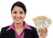 Business woman holding Indian currency notes. Happy young business woman holding Indian currency notes Royalty Free Stock Photos