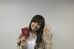 Business woman holding Japanese passport with OK sign Royalty Free Stock Image