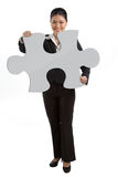 Business woman holding a jigsaw piece. Stock Image