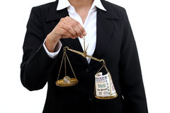 Business woman holding the justice scale Royalty Free Stock Photos