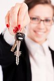 Business woman holding keys Royalty Free Stock Image