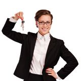 Business woman holding keys Royalty Free Stock Photos