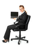 Business woman holding laptop with blank screen Stock Images