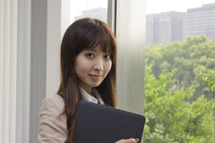 Business woman holding Laptop computer. Asian business woman holding Laptop computer Stock Photos