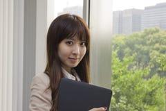 Business woman holding Laptop computer Stock Photos