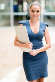 Business woman holding a laptop Royalty Free Stock Images
