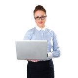 Business woman holding laptop in hand. Young stylish business woman isolated on white. White caucasian redhead female model royalty free stock image