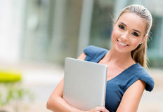 Business woman holding laptop Stock Image