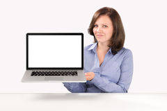 Business woman is holding a laptop. In her hands and demonstrating something on it, business concept royalty free stock images
