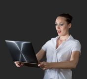 Business woman holding a laptop. Image of young business woman holding laptop stock photo