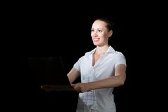 Business woman holding a laptop. Image of young business woman holding laptop royalty free stock photography