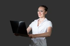 Business woman holding a laptop. Image of young business woman holding laptop royalty free stock photos