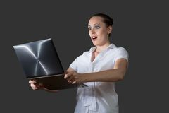 Business woman holding a laptop. Image of young business woman holding laptop stock photography