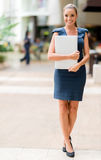 Business woman holding laptop Stock Photos