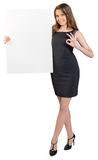 Business woman holding a large blank billboard and Royalty Free Stock Images