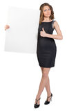 Business woman holding a large blank billboard and Royalty Free Stock Photo
