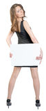Business woman holding a large blank billboard and Stock Photos