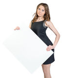 Business woman holding a large blank billboard and Royalty Free Stock Photography