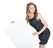 Business woman holding a large blank billboard and Stock Photo