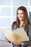 Business woman holding legal documents Royalty Free Stock Photo
