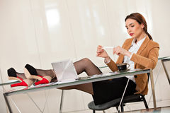 Business woman holding legs on the desk Royalty Free Stock Photography