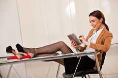 Business woman holding legs on the desk Royalty Free Stock Photo