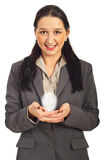 Business woman holding light bulb Stock Image