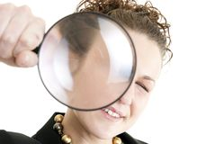 Business woman holding a magnifying glass Stock Photo